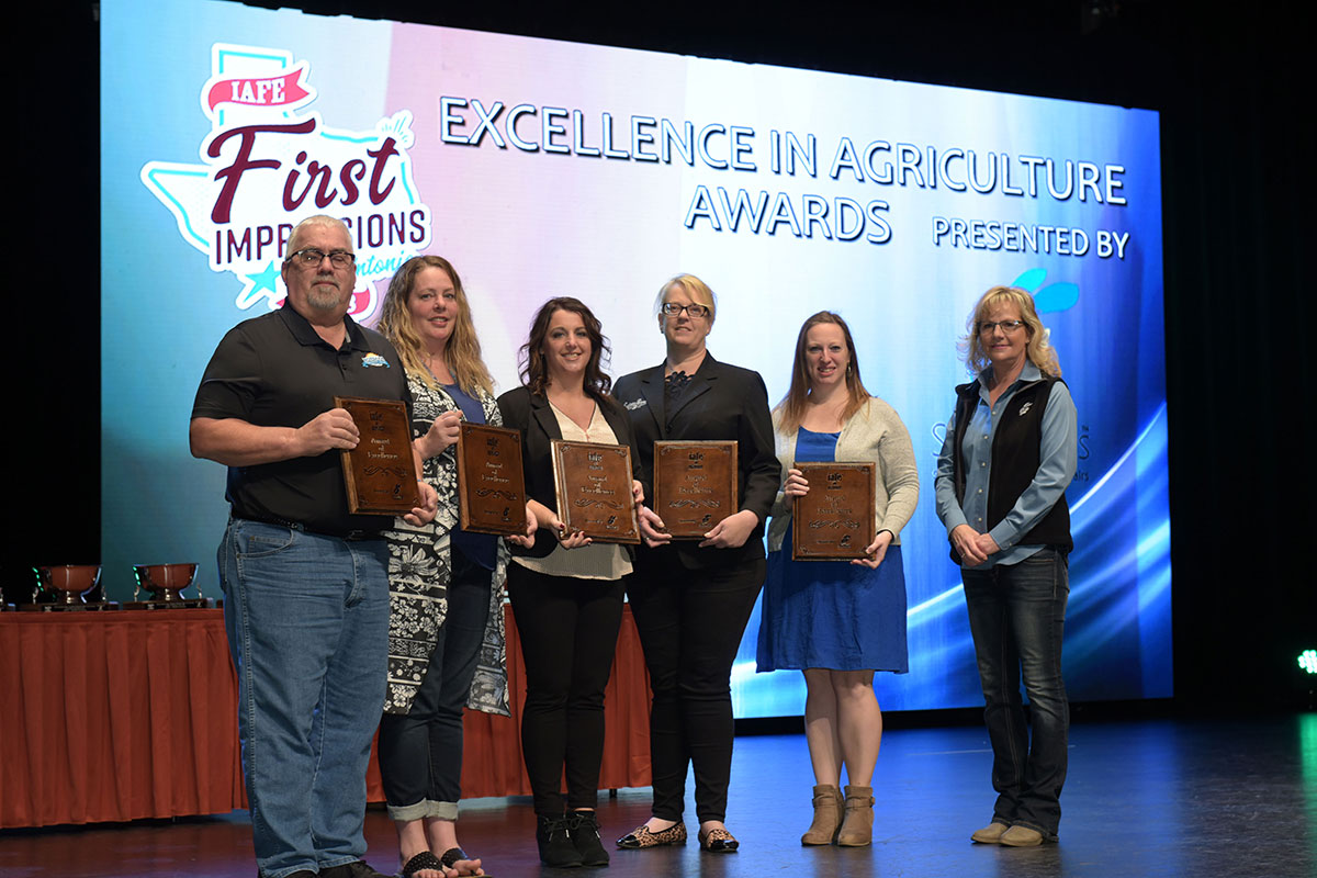 Lonna Breshears accepting the award for Excellence in Agriculture