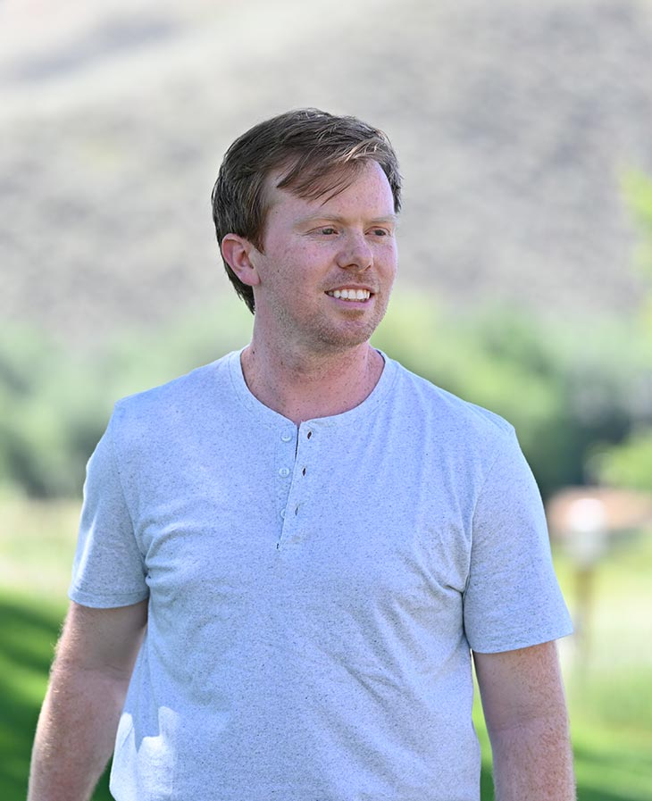 Cameron Stewart walking on golf course