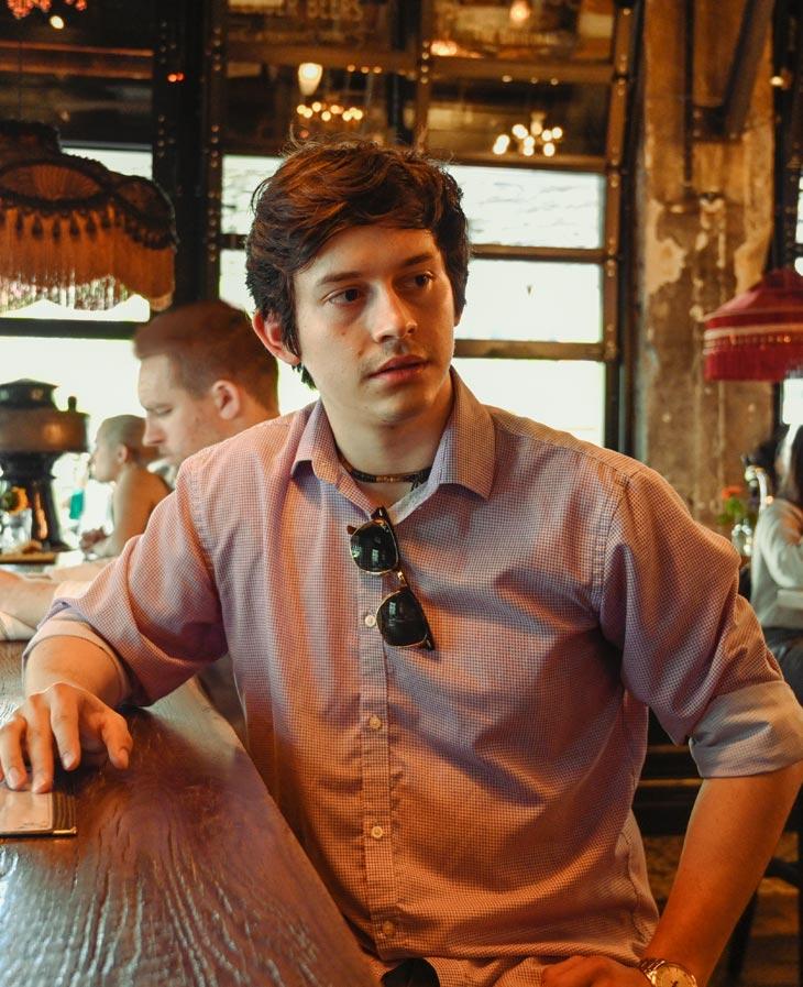 Antonio Gallegos sitting at bar top